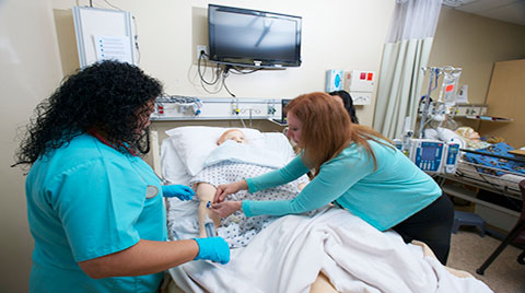 students practice caring for patient