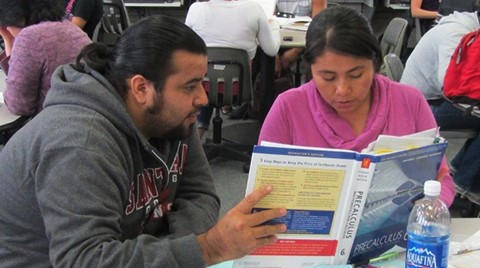 Santa Ana College tutor assisting SAC student in math