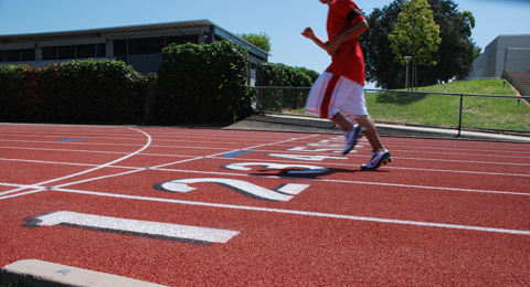 A SAC student running on the track