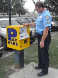 Security officer demonstration parking pass machine